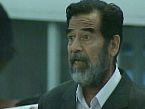 legal issues; via aptn iraq: baghdad: int court cms saddam hussein speaking in court on first day of his trial on charges including pre-meditated... - saddam hussein stock videos & royalty-free footage