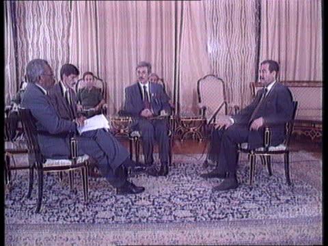 Saddam Hussein's first target will be Israel MS Iraqi Pres Saddam Hussein seated with ITN reporter Trevor McDonald translators CMS Saddam speaking