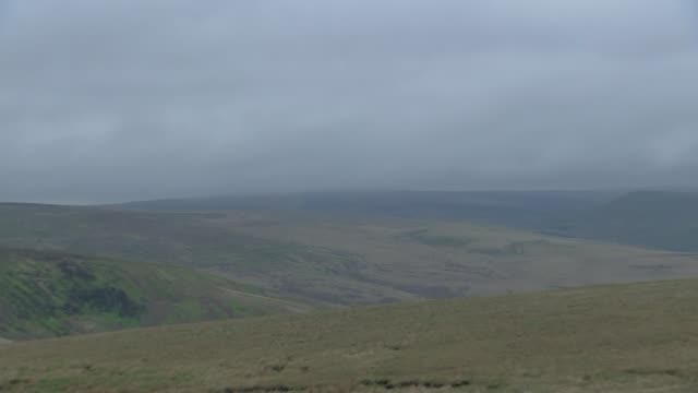 Greater Manchester Oldham Saddleworth Moor EXT General views moorland site of Moors murders / Flowers and photograph on post