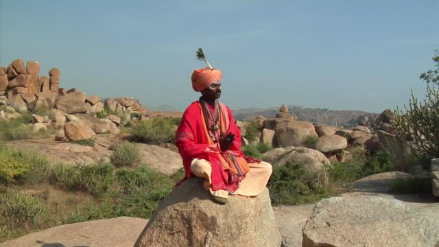 WS, Sadhu meditating on rock, Hampi, Karnataka, India