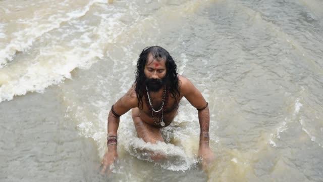 A Sadhu (Holy Man) offering prayer during Simhastha Kumb.