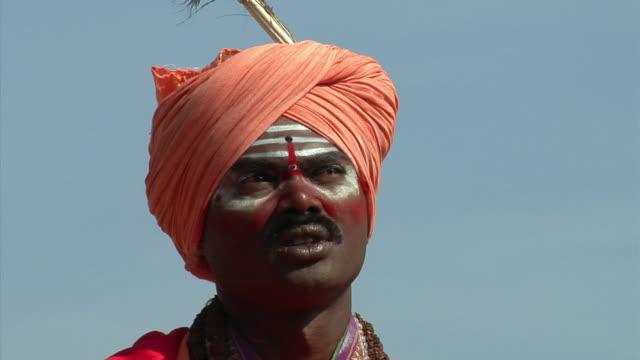 CU, Sadhu praying outdoors, Hampi, Karnataka, India