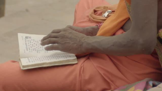 c/u sadhu reading a book, hands - hinduism stock videos & royalty-free footage