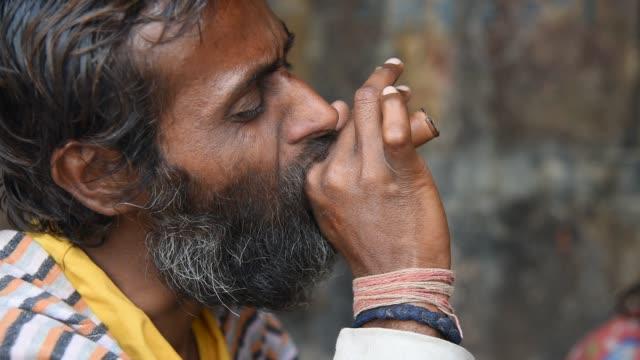 sadhu smoking pipe with marijuana. - narcotic stock videos & royalty-free footage