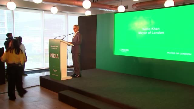 sadiq khan begins first leg of trade mission / student visa issue india mumbai int sadiq khan into meeting room holding bunch of flowers/ sadiq khan... - first leg stock videos and b-roll footage