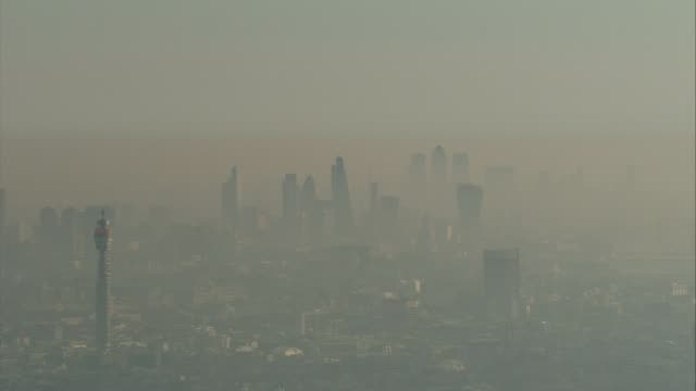 sadiq khan calls for wood burning stoves to be banned in london lib / tx smog clouds around city of london skyscrapers - sadiq khan stock videos & royalty-free footage
