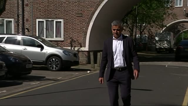 sadiq khan confirms plan to be labour candidate for mayor of london england london ext windows of council estate building tilt down sadiq khan mp... - sadiq khan stock videos & royalty-free footage