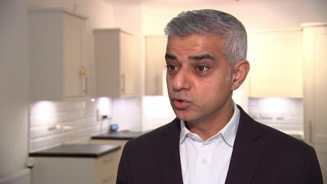 sadiq khan defends housing policy england london ealing int sadiq khan interview sot - ealing stock videos and b-roll footage