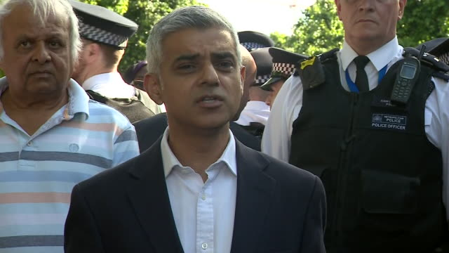 sadiq khan is heckled by residents near the site of grenfell tower - public speaker stock videos and b-roll footage