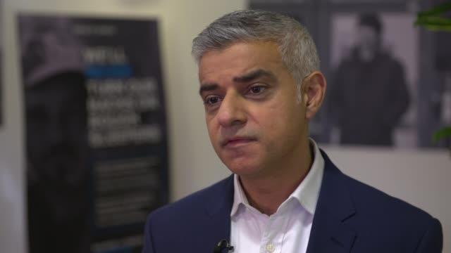 Sadiq Khan launches new rough sleeping campaign ENGLAND London Hackney INT Sadiq Khan wearing hard hat and high viz vest pushing bricks out of...