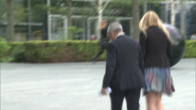 London City Hall EXT Back view Sadiq Khan MP leaving City Hall after his first day at work