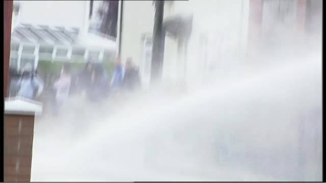 sadiq khan plans to sell water cannons bought by boris johnson; lib northern ireland: belfast: water cannon used to disperse rioters - water cannon stock videos & royalty-free footage