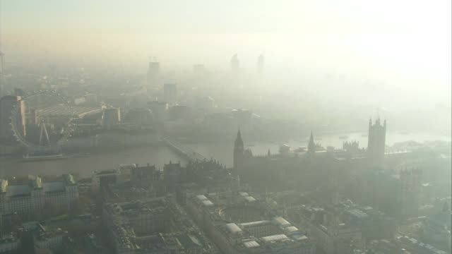sadiq khan reveals 'national park city' plan for london air view aerial london skyline including houses of parliament with smog visible - sadiq khan stock videos & royalty-free footage