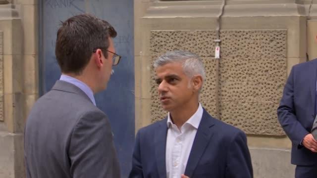 Sadiq Khan to run for second term as Mayor of London UK London Sadiq Khan Andy Burnham and Steve Rotherham posing in doubledecker bus entrance ahead...