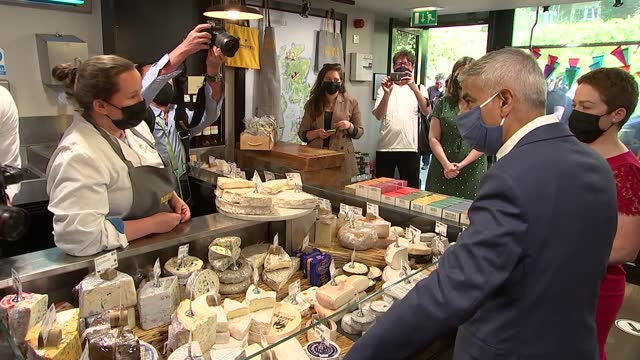 sadiq khan visits piccadilly business and shops; england: london: jermyn street: ext sadiq khan and ros morgan along jermyn street and into paxton... - dairy product stock videos & royalty-free footage