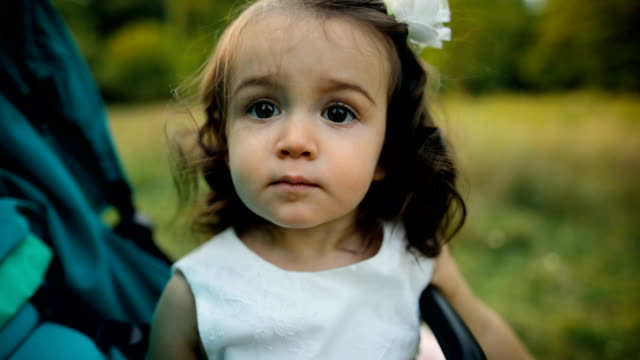 sadness baby girl in stroller outdoors in autumn - pushchair stock videos & royalty-free footage