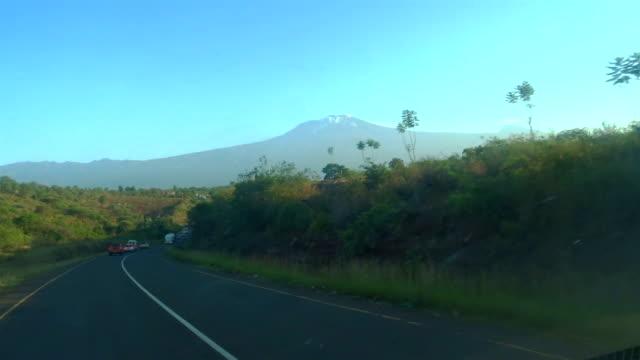 safari adventure. kilimanjaro in background. - mt kilimanjaro stock videos & royalty-free footage