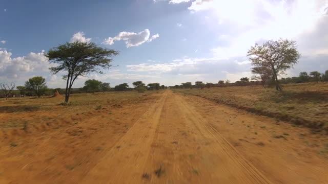 MS T/L POV Safari vehicle driving through desert / Windhoek, Namibia