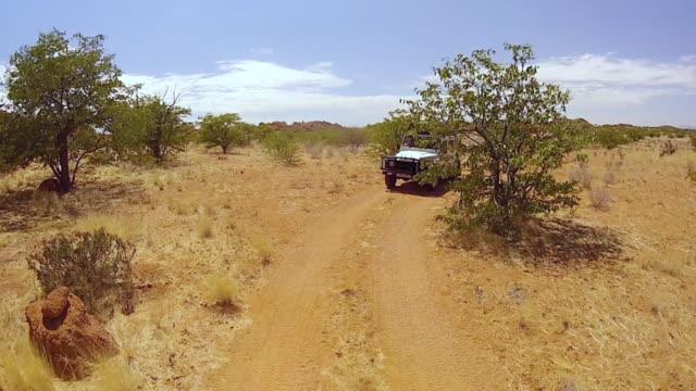 ms safari vehicle driving through namibian desert / windhoek, namibia - namibian desert stock videos and b-roll footage