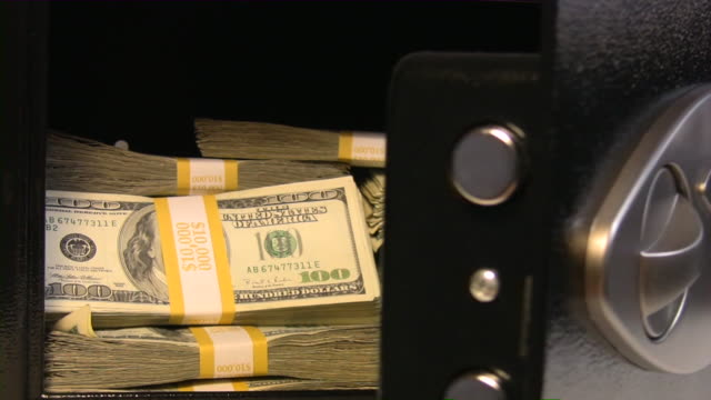 Safe full of American dollars. Money, cash, US currency, banking.