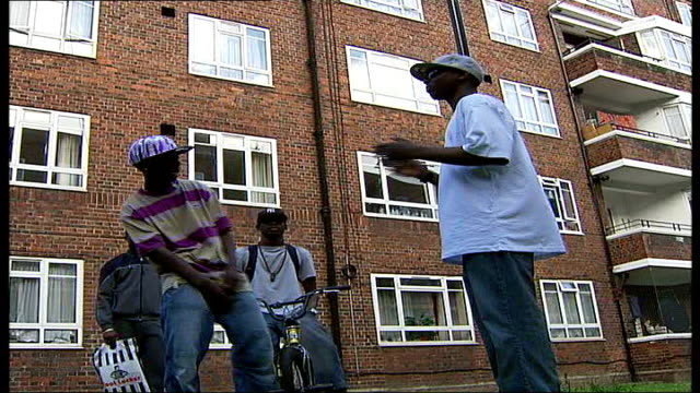 safe houses suggested for gang members' escape england london ext black teenager rapping with his friends sot czee interview sot - hip hop stock-videos und b-roll-filmmaterial