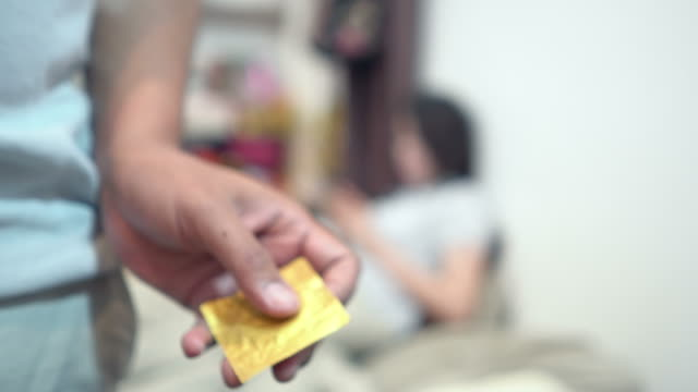 safe sex - condom stock videos and b-roll footage