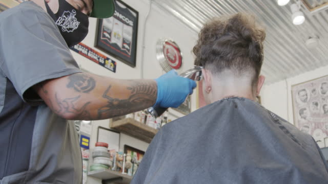 safely visiting the barbershop during covid-19 coronavirus pandemic - cutting hair stock videos & royalty-free footage
