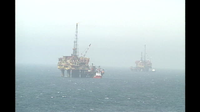 safety failings uncovered 2 years after shell brent bravo accident air views aerials north sea oil platforms - safety stock videos & royalty-free footage