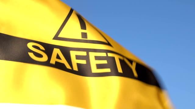 vídeos y material grabado en eventos de stock de bandera de seguridad ondeando en el cielo - signo de puntuación