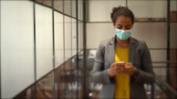Safety in the office during COVID-19 pandemic, businesspeople with face masks