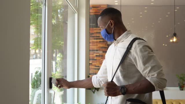 safety in the office during covid-19 pandemic - office doorway stock videos & royalty-free footage