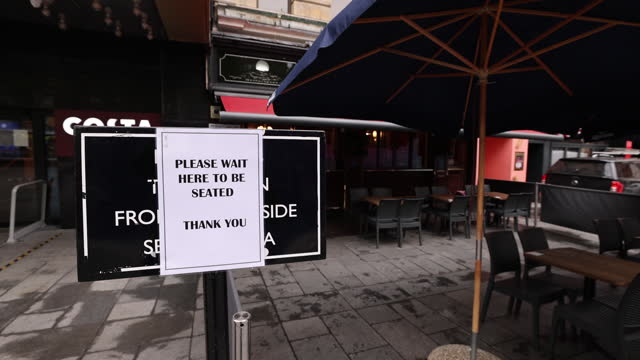 safety sign outside reopened wetherspoons pub in central london, uk, on monday, may 17, 2021. - new normal concept stock videos & royalty-free footage