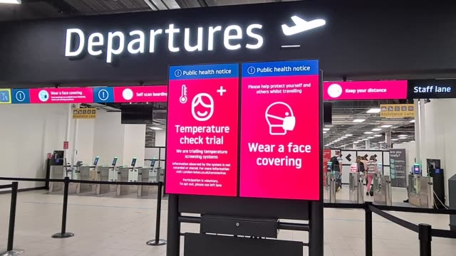 safety signs are in place at the security departures at flight transport during coronavirus on july 25, 2020 in luton, england - security stock videos & royalty-free footage