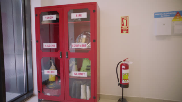 safety signs - danger, warning and caution labels - fire cabinet and fire extinguisher - fire extinguisher stock videos & royalty-free footage