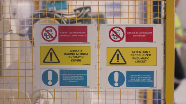safety signs - danger, warning and caution labels - production line - hazardous area sign stock videos & royalty-free footage