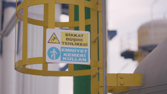 vídeos de stock e filmes b-roll de safety signs - danger, warning and caution labels - safety harness - ponto de exclamação