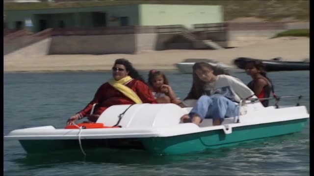 safia gaddafi and daughter aisha in pedal boat with two young girls at gaddafi's seaside compound in tripoli younger girl is hana allegedly the... - pedal boat stock videos and b-roll footage