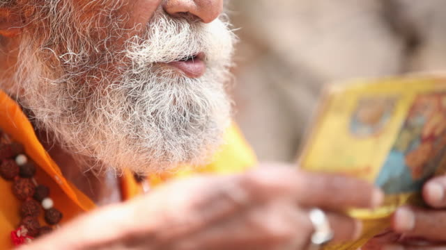 sage reading a religious book, haridwar, uttarakhand, india - hinduism stock videos & royalty-free footage