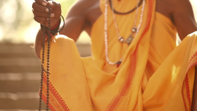 sage with prayer beads, faridabad, haryana, india - prayer beads stock videos & royalty-free footage