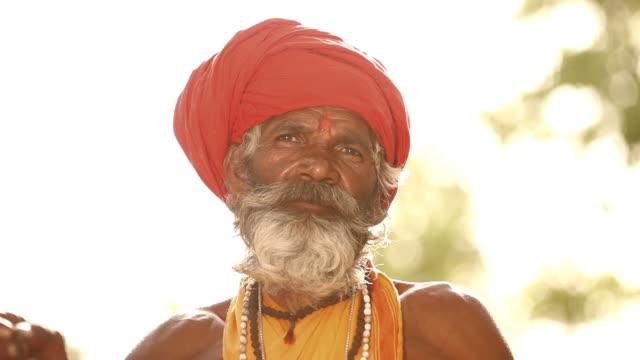 sage with prayer beads, faridabad, haryana, india - haryana stock-videos und b-roll-filmmaterial