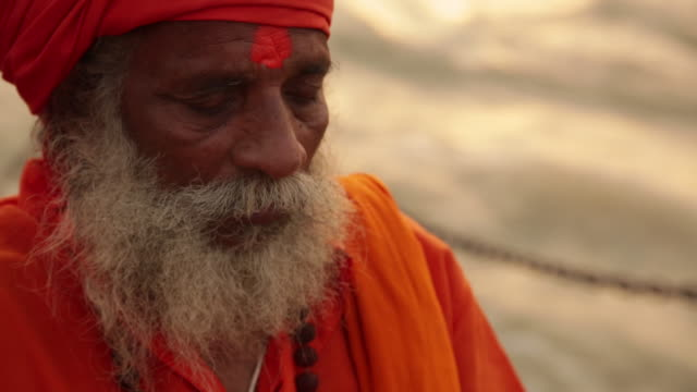 Sage worshipping at riverbank, Ganges River, Haridwar, Uttarakhand, India