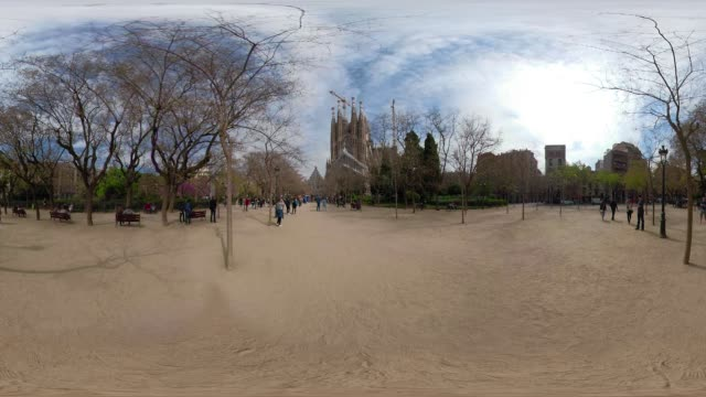 Sagrada Familia 360 degree video. Passion facade of this basilica by Gaudi from the park. VR equirectangular panorama
