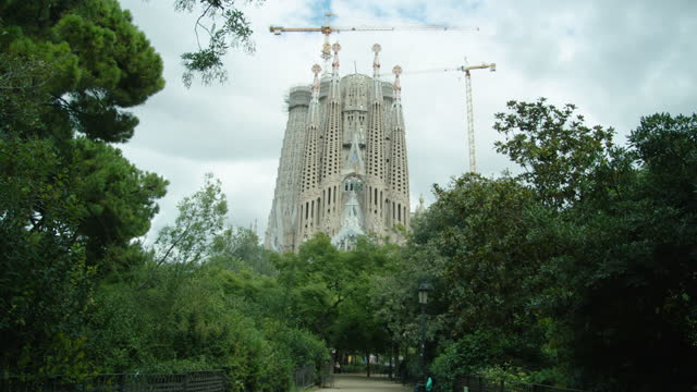 sagrada familia barcelona establishing shot. passion facade - spanish culture stock videos & royalty-free footage
