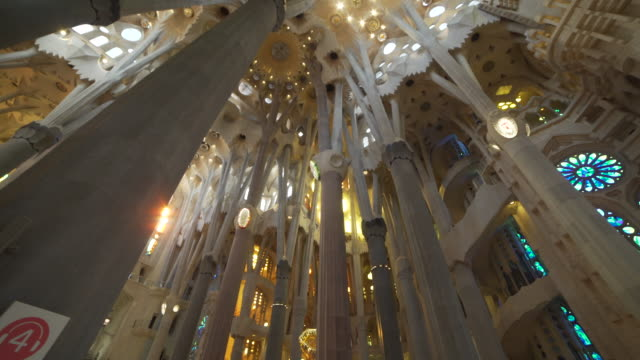 sagrada familia by gaudi indoors at barcelona - sagrada familia stock-videos und b-roll-filmmaterial