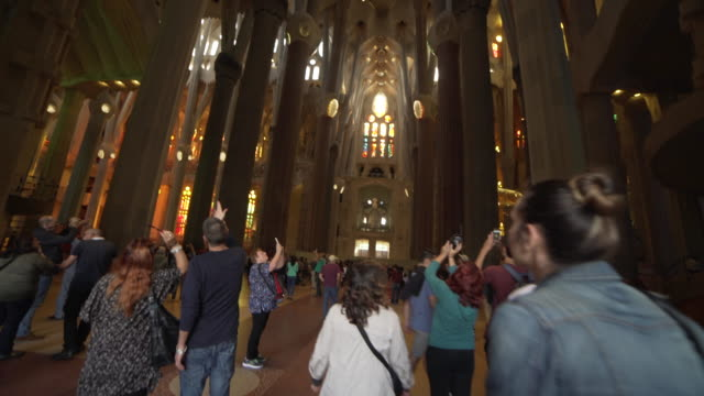 sagrada familia by gaudi indoors at barcelona - barcelona stock-videos und b-roll-filmmaterial