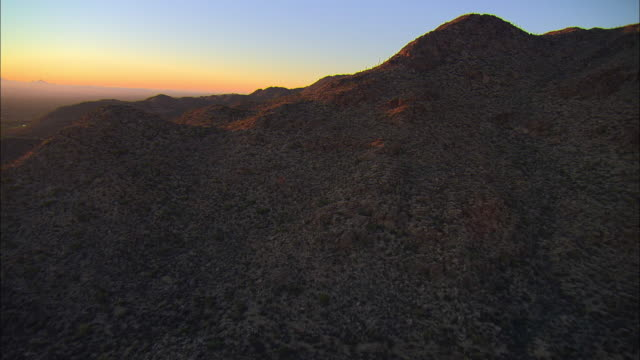 AERIAL Saguaro cactus covered mountains at sunset, Tucson, Arizona, USA