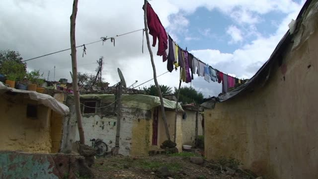 stockvideo's en b-roll-footage met sahb al kaid is a ramshackle slum that lies across the river from rabat in the capitals twin city of sale where residents are losing faith in... - sale