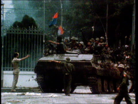 bv soldier watching as american plane over and drops bomb in distance ms vietcong tank towards into presidential compound at fall of saigon ms... - south vietnam stock videos & royalty-free footage