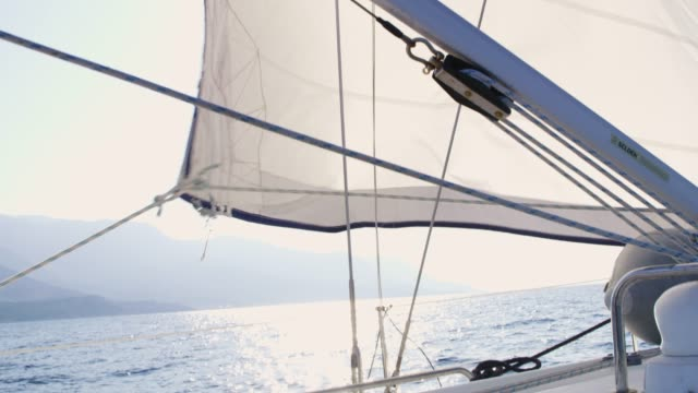 sail and rigging being adjusted on sunny sailboat, real time - rigging nautical stock videos & royalty-free footage