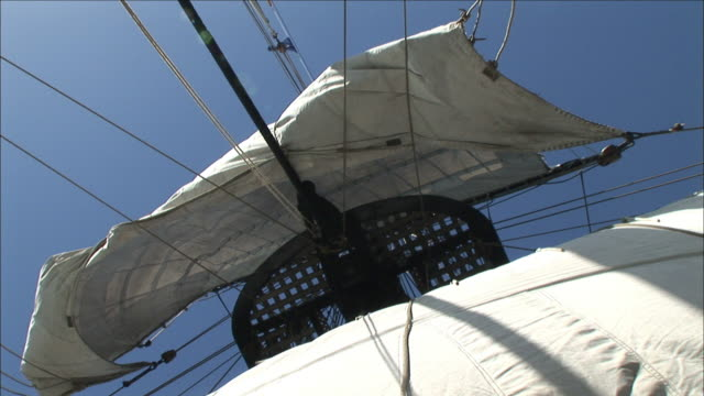 a sail billows in the wind on a tall ship. - sail stock videos and b-roll footage